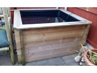 QUALITY WOOD PATIO POND 260 gallons 4.5 FT X 4.5 FT,3FT HEIGHT APPROX.GOOD CONDITION