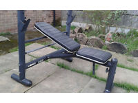 Bench press with leg extentions and adjustable seat