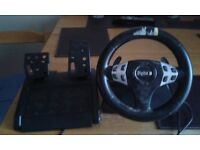 PS2 Steering wheel and foot pedal and two ps2 controllers