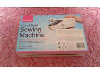 HAND HELD SEWING MACHINE. Brand new, boxed, never used.