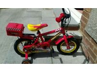Brilliant Red Firechief first bike with stabilizers.New condition