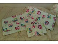 2 Cot bed sets and curtains.