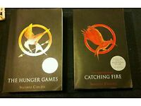 'The Hunger Games' and 'Catching Fire' books by Suzanne Collins for sale.