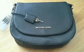 Black Michael Kors handbag.