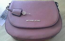 Brown Michael Kors women handbag.
