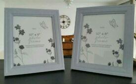 "A pair Next of 10""x8"" photo frames"