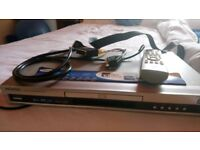 DVD player with remote control and leads.