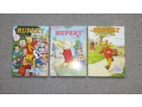 3 no Rupert the Bear Books and 1 Tintin books
