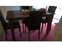 Lovely dark wood excellent condition dining table and four leather seat and back chairs
