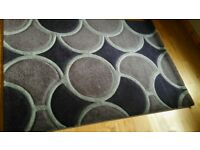 Purple coloured circle patterned rug