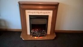 Lovely wood effect fireplace and electric fire