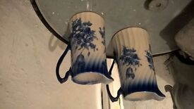 Blue and white decorative jugs