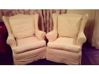Matching pair of old cream wingback chairs. Offers accepted