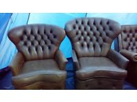 Big John, Little John leather Chesterfield armchairs.