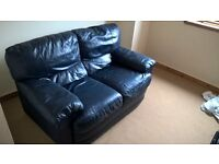 free blue two seater leather suite.