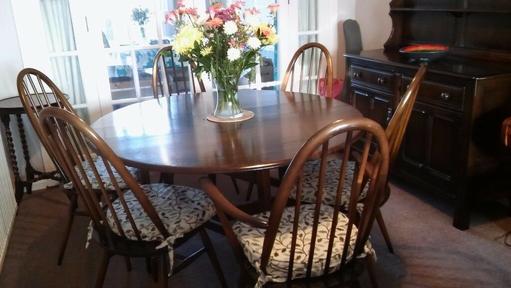 Oval Ercol dining table with 6 chairs