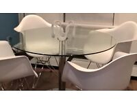 Dwell large glass and chrome dining table with with 4 Eames Dar chairs