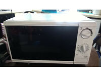 Tesco Solo Microwave. Nearly new.