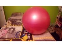 Exercise/yoga ball and foot pump