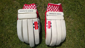 Cricket batting gloves, two sets
