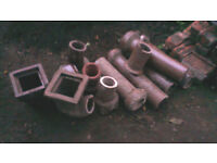 collection of clay pipes and fittings for flower pots etc