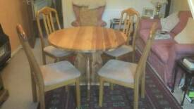 Round pine kitchen/dining table and 4 high back chairs