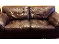 Brown leather three seater sofa and snuggle chair