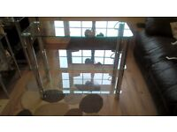 clear glass and chrome console table