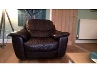 dark brown 3 piece leather suite including 4 seater and 3 seater sofas and an armchair