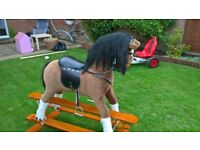 Large Rocking Horse in very good condition, Includes a burgundy blanket.