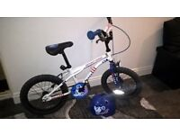 small boys bike with helmet. suit ages 4-7 approx. originally bought from Halfords. buyer to collect