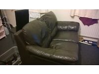 Dark brown real leather 2 seater settee.