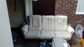 Beige 3 seater Sofa with wooden sides/arms