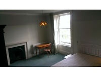 A good sized sunny quiet room in a central West End flat.