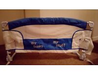 Bed rail with labelled storage pockets