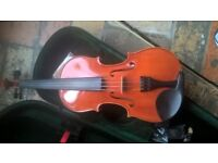 Full size Violin and new case.