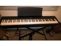 Selling KAWAI ES100 digital piano £370, perfect condition. INC Stand