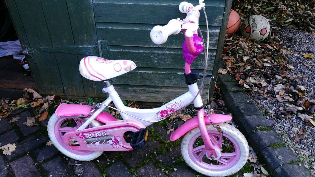 Pink girl's bike with stabilizers