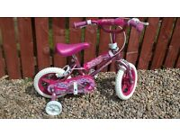 Girls 12 inch bike with stabalisers. Only used once.