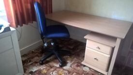 Desk with matching drawer unit and blue wheelie chair
