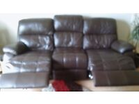 Chocolate brown leather 3 seater sofa with electric recliners.Good condition.