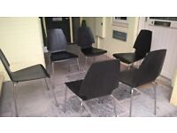 If you have the table - we have the chairs! 6 modern black dining chairs to be precise.