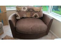 SCS Brown and pattern fabric swivel cuddle chair