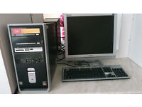 Compaq Desktop PC with Monitor and Keyboard.