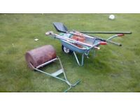 Garden wheelbarrow roller and tools