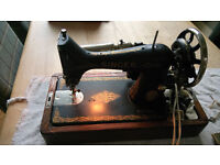 Antique beautifully crafted Singer Sewing machine with Electric Motor