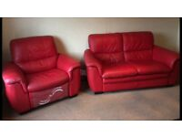 Red leather two seater sofa and matching electric recliner chair