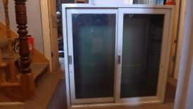 Good size sold wood vintage cupboard with sliding glass doors, for upcycling, home / office /storage