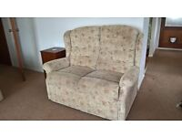 upright patterned 2 seater sofa