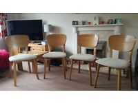 4 solid wood dining room chairs with cream seat pads